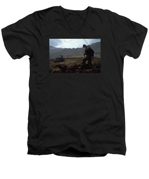Men's V-Neck T-Shirt featuring the photograph Boots On The Ground by Travel Pics