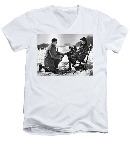 Man Lends A Helping Hand To Put On Skates Men's V-Neck T-Shirt by Underwood Archives