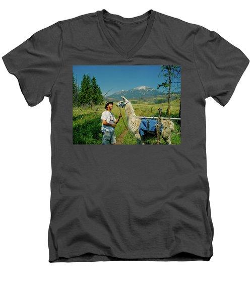 Man Teasing A Llama Men's V-Neck T-Shirt by Jerry Voss