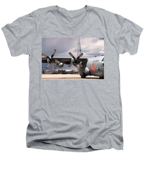Men's V-Neck T-Shirt featuring the photograph Maffs C-130s At Cheyenne by Bill Gabbert
