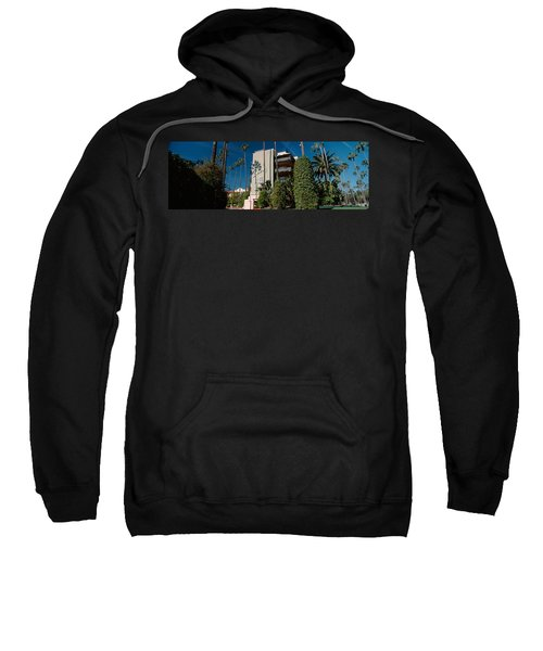 Trees In Front Of A Hotel, Beverly Sweatshirt by Panoramic Images