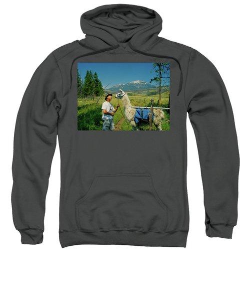 Man Teasing A Llama Sweatshirt by Jerry Voss