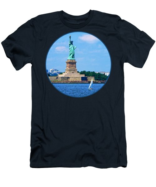 Manhattan - Sailboat By Statue Of Liberty Men's T-Shirt (Slim Fit) by Susan Savad