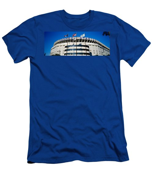 Flags In Front Of A Stadium, Yankee Men's T-Shirt (Slim Fit) by Panoramic Images