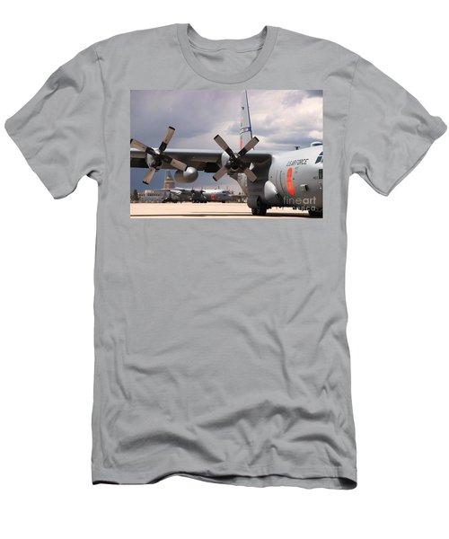 Men's T-Shirt (Slim Fit) featuring the photograph Maffs C-130s At Cheyenne by Bill Gabbert