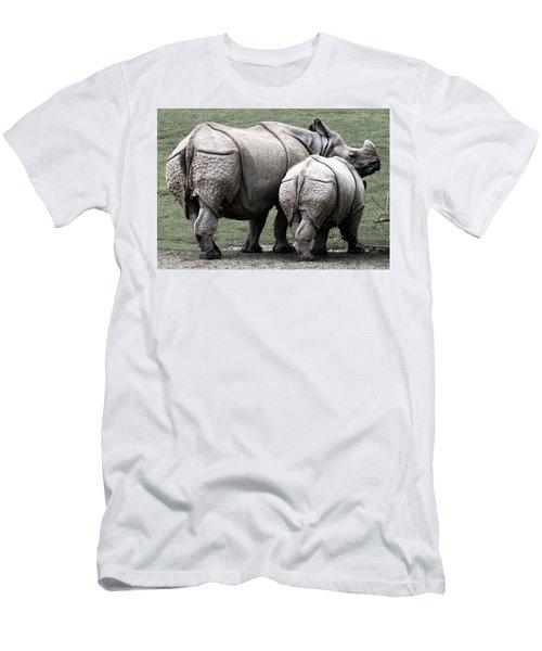 Rhinoceros Mother And Calf In Wild Men's T-Shirt (Slim Fit) by Daniel Hagerman