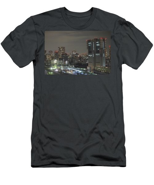 Docomo Tower Over Shinagawa Station And Tokyo Skyline At Night Men's T-Shirt (Slim Fit) by Jeff at JSJ Photography