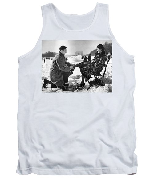 Man Lends A Helping Hand To Put On Skates Tank Top by Underwood Archives