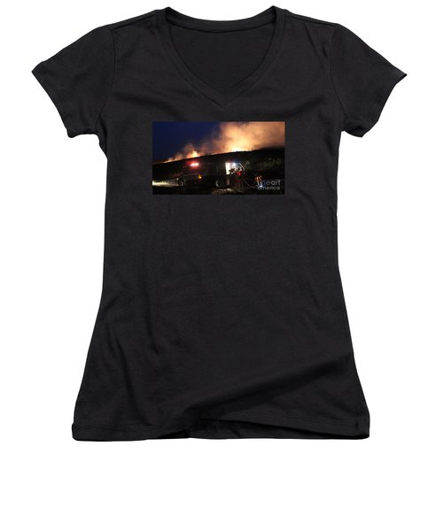 Women's V-Neck T-Shirt (Junior Cut) featuring the photograph An Engine Crew Works At Night On White Draw Fire by Bill Gabbert