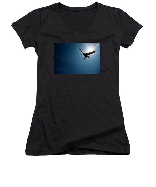 Vulture Flying In Front Of The Sun Women's V-Neck T-Shirt (Junior Cut) by Johan Swanepoel