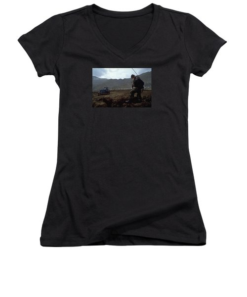 Women's V-Neck T-Shirt (Junior Cut) featuring the photograph Boots On The Ground by Travel Pics