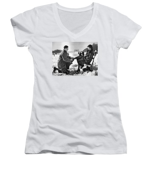 Man Lends A Helping Hand To Put On Skates Women's V-Neck T-Shirt (Junior Cut) by Underwood Archives