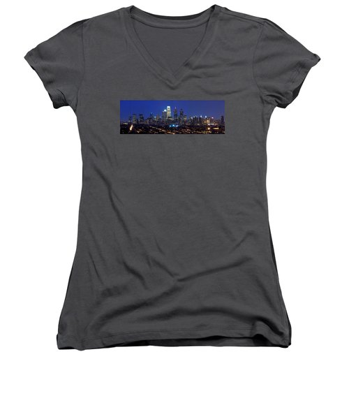 Buildings Lit Up At Night In A City Women's V-Neck T-Shirt (Junior Cut) by Panoramic Images