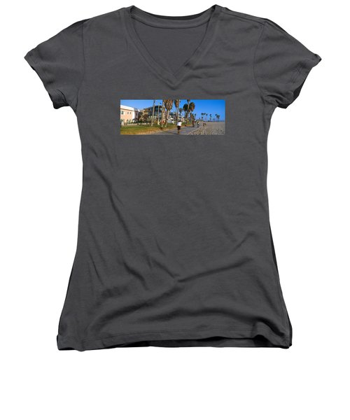 People Riding Bicycles Near A Beach Women's V-Neck T-Shirt (Junior Cut) by Panoramic Images