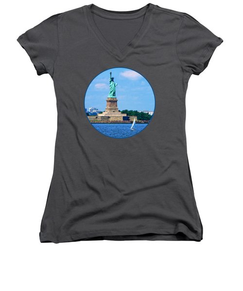 Manhattan - Sailboat By Statue Of Liberty Women's V-Neck T-Shirt (Junior Cut) by Susan Savad