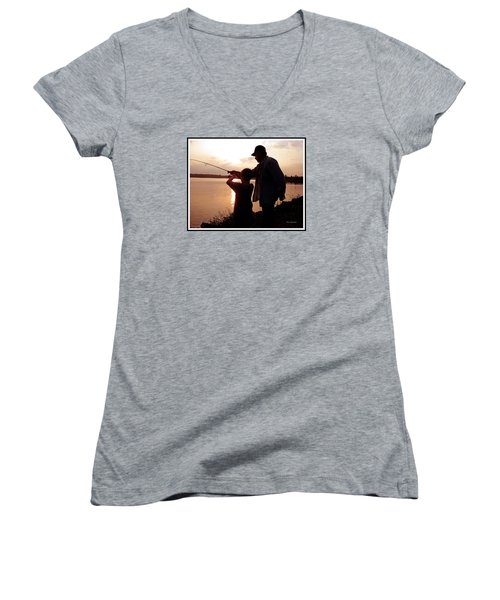 Women's V-Neck T-Shirt (Junior Cut) featuring the photograph Fishing At Sunset Grandfather And Grandson by A Gurmankin