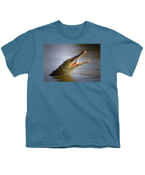 Nile Crocodile Swollowing Fish Youth T-Shirt by Johan Swanepoel