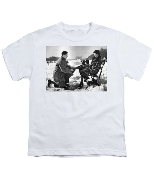 Man Lends A Helping Hand To Put On Skates Youth T-Shirt by Underwood Archives