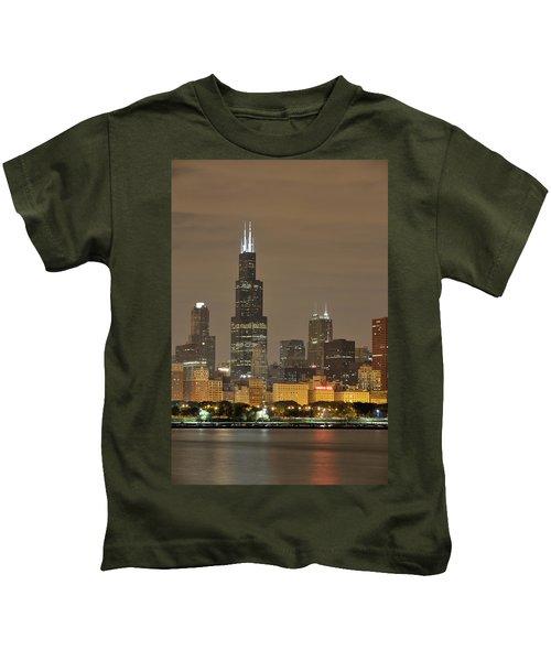 Chicago Skyline At Night Kids T-Shirt by Sebastian Musial