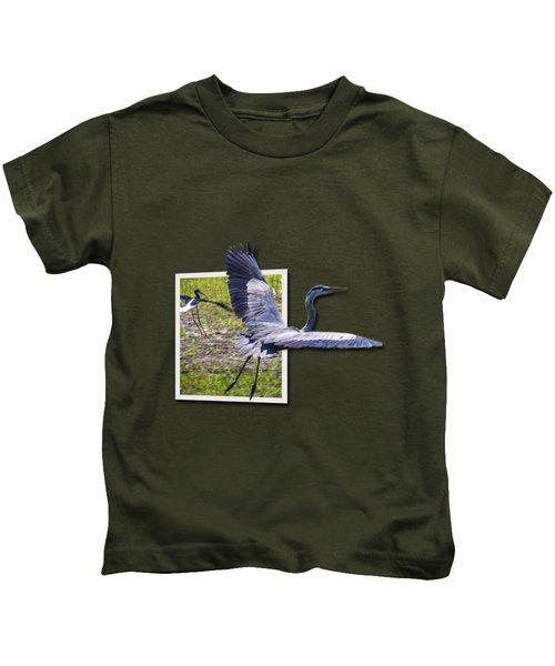 Great Blue Heron Takes Flight Kids T-Shirt by Roger Wedegis