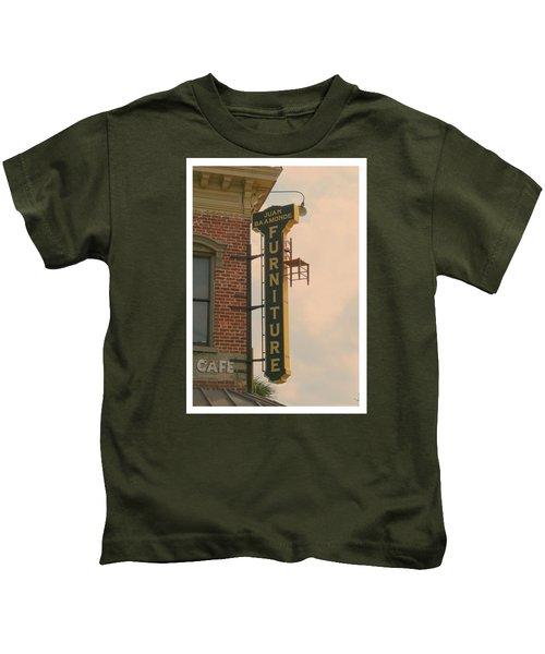Juan's Furniture Store Kids T-Shirt by Robert Youmans