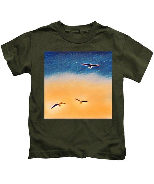 Seagulls Flying In The Burning Sky Kids T-Shirt by Paul Mc Namara