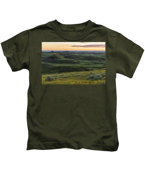 Sunset Over Killdeer Badlands Kids T-Shirt by Robert Postma