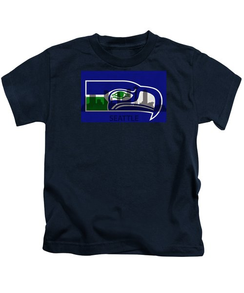 Seattle Seahawks On Seattle Skyline Kids T-Shirt by Dan Sproul
