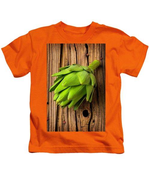 Artichoke On Old Wooden Board Kids T-Shirt by Garry Gay