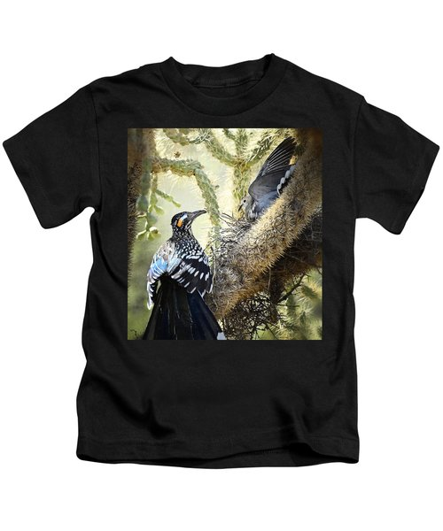 The Dove Vs. The Roadrunner Kids T-Shirt by Saija  Lehtonen