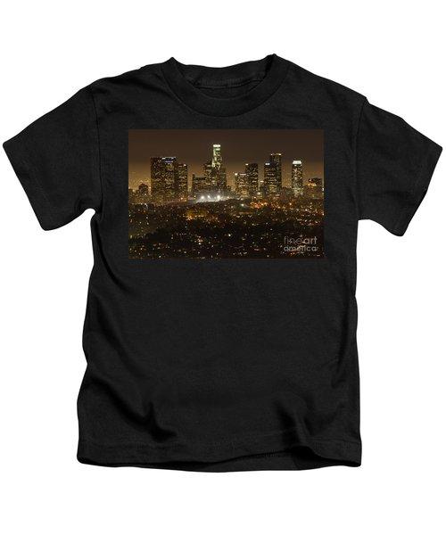 Los Angeles Skyline At Night Kids T-Shirt by Bob Christopher