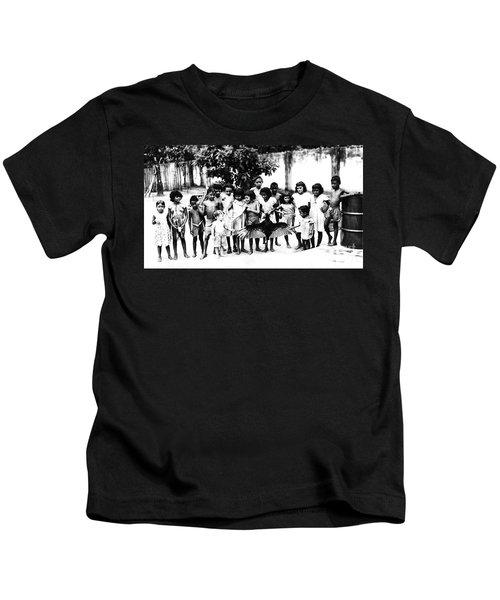 In The Amazon 1953 Kids T-Shirt by W E Loft