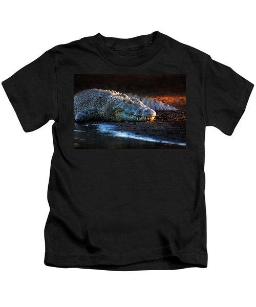Nile Crocodile On Riverbank-1 Kids T-Shirt by Johan Swanepoel