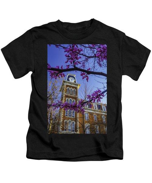 Redbud At Old Main Kids T-Shirt by Damon Shaw