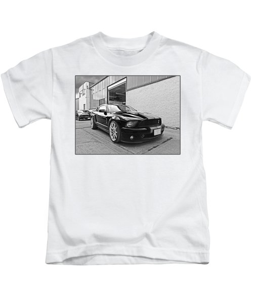 Mustang Alley In Black And White Kids T-Shirt by Gill Billington