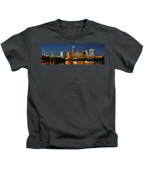 Austin Skyline At Night Color Panorama Texas Kids T-Shirt by Jon Holiday