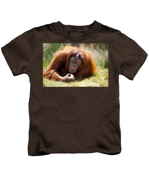 Orangutan In The Grass Kids T-Shirt by Garry Gay