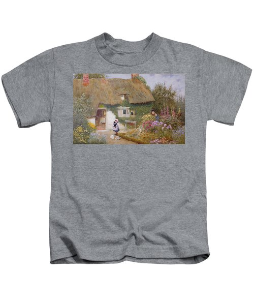 Feeding The Pigeons Kids T-Shirt by Arthur Claude Strachan