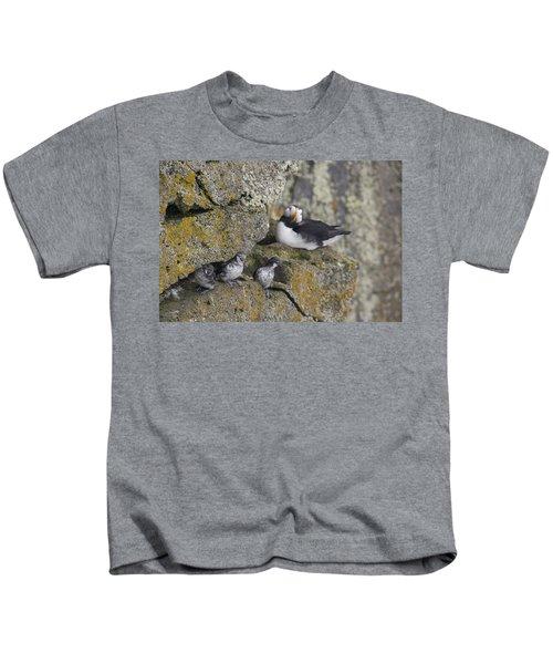 Least Auklets Perched On A Narrow Ledge Kids T-Shirt by Milo Burcham