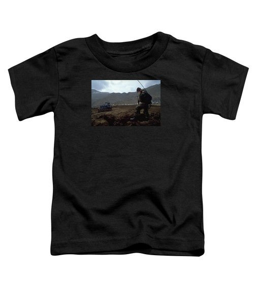 Toddler T-Shirt featuring the photograph Boots On The Ground by Travel Pics