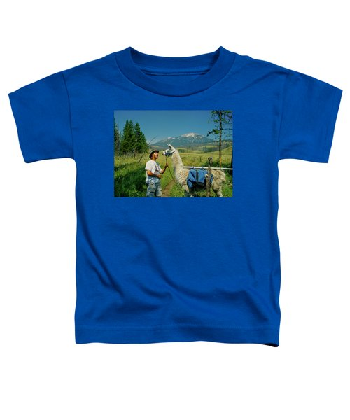 Man Teasing A Llama Toddler T-Shirt by Jerry Voss