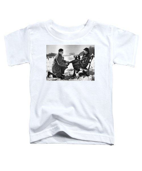 Man Lends A Helping Hand To Put On Skates Toddler T-Shirt by Underwood Archives