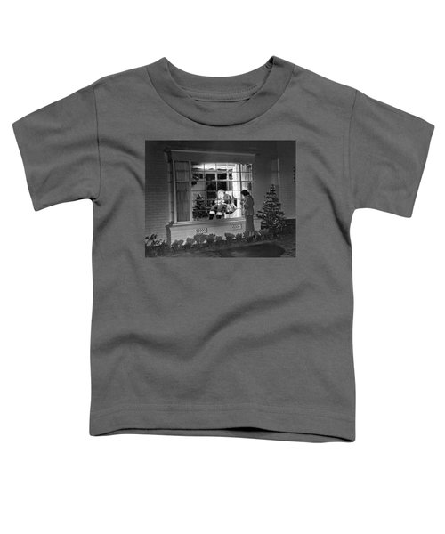 This Beverly Hills Resident Is Putting The Finishing Touches On Toddler T-Shirt by Underwood Archives