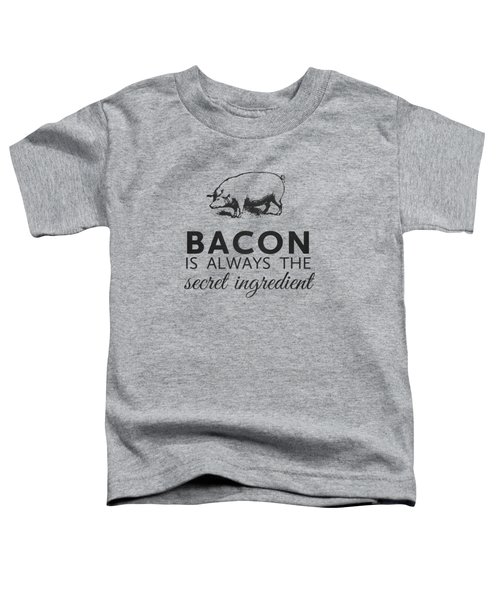 Bacon Is Always The Secret Ingredient Toddler T-Shirt by Nancy Ingersoll