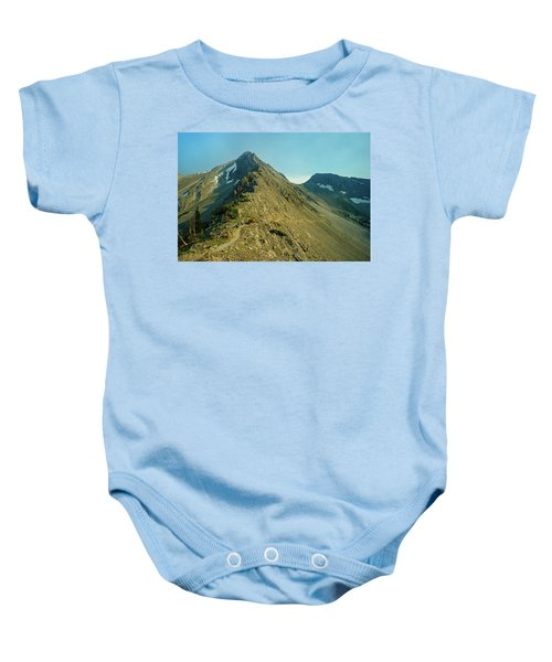 Llama Packer Hiking A Steep Rocky Mountain Peak Trail Baby Onesie by Jerry Voss