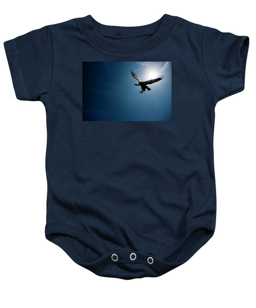 Vulture Flying In Front Of The Sun Baby Onesie by Johan Swanepoel