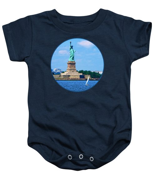 Manhattan - Sailboat By Statue Of Liberty Baby Onesie by Susan Savad