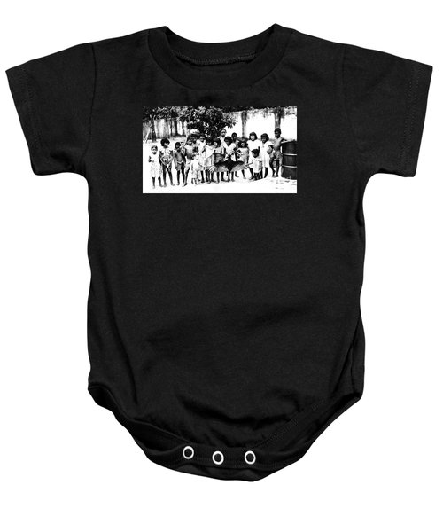 In The Amazon 1953 Baby Onesie by W E Loft