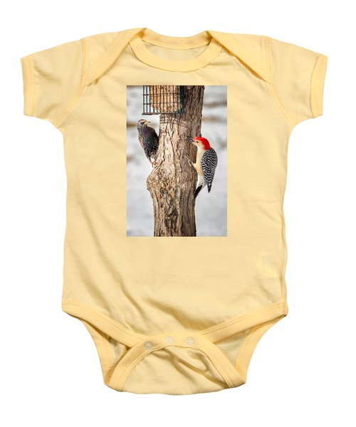 Bird Feeder Stand Off Baby Onesie by Bill Wakeley