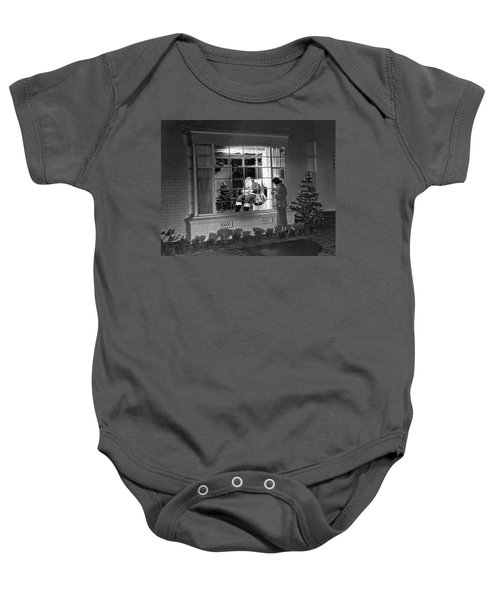 This Beverly Hills Resident Is Putting The Finishing Touches On Baby Onesie by Underwood Archives